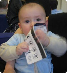 6 month old E eating his airline ticket
