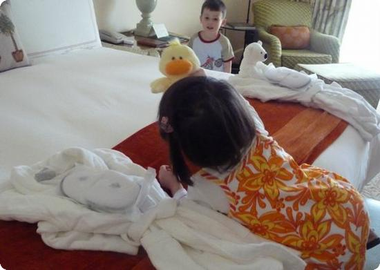 D & E investigate the child sized robes and slippers at the Four Seasons Aviara