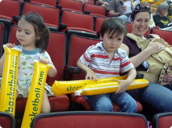 The kids are ready to whack their noisemakers together