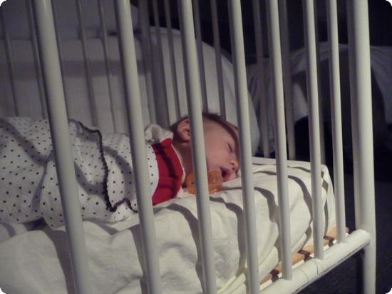Eilan resting comfortably in a hotel crib
