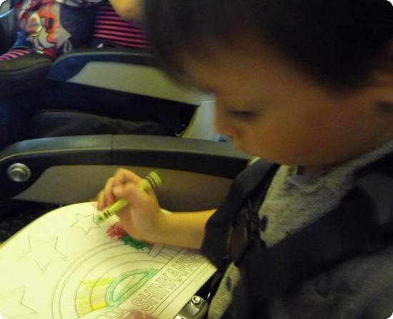 E is entranced by his train coloring book