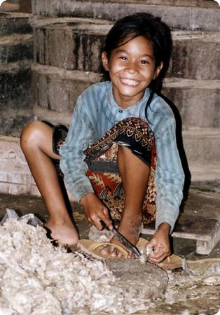 Child Worker in a Fish Paste Factory in Batambang Cambodia