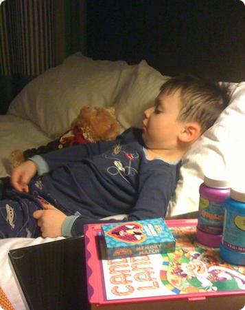 Snuggling up for bed (note the cute airplane pjs)