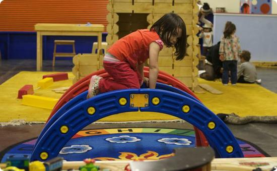 D Climbs On One Of The Indoor Play Structures At Scientopia