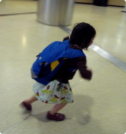 D runs through the airport to catch her flight