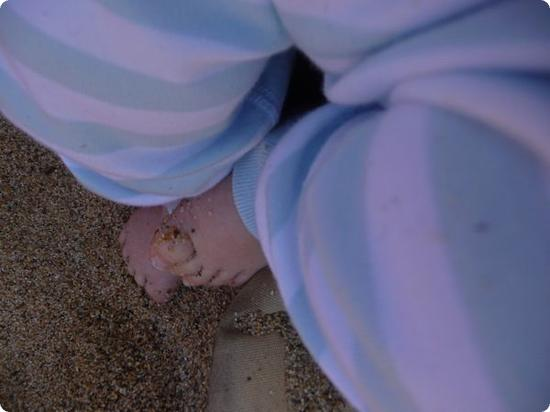 Eilan's little baby feet in the sand for the first time ever