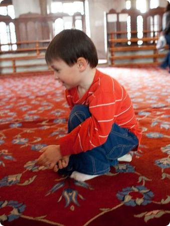 E hangs out on the carpet of the Blue Mosque in Istanbul