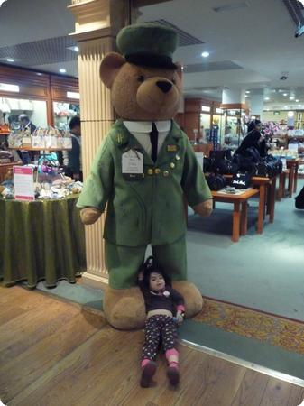 D sacked out with the Harrods bear at Heathrow Airport
