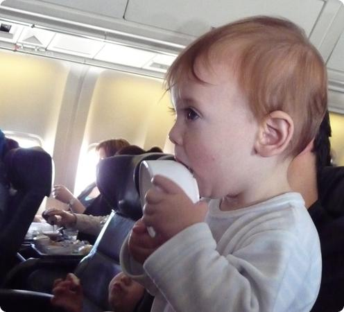 Eilan mouths an empty cup on our flight to Istanbul