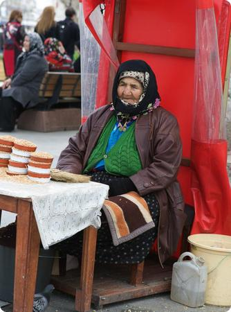 Woman selling pigeon feed outside of Istanbul's New Mosque