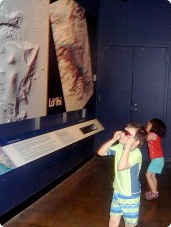 The kids don 3d glasses to check out an image of volcano Lo'ihi's crater