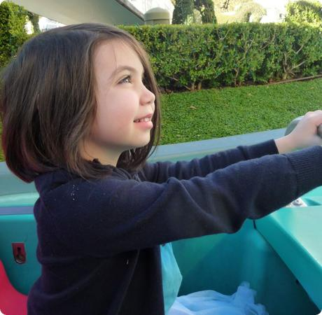 Darya settles into a boat at small world