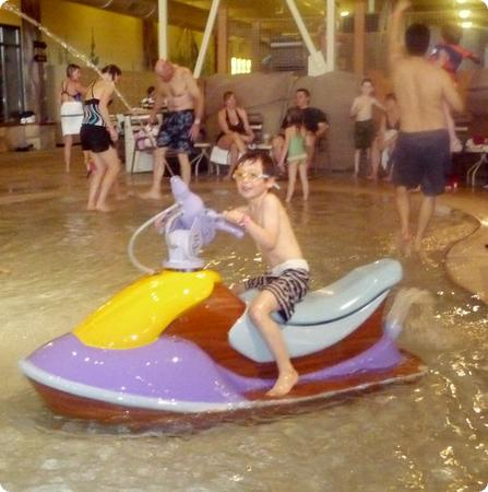 "Everest on a ""jetski"" at Great Wolf Lodge.  Don't worry, it doesn't move."