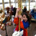 Darya hangs on tight on the Carousel at Yerba Buena in San Francisco