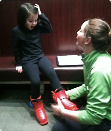 Darya gets fitted for ski boots at the Four Seasons Resort in Whistler, Canada