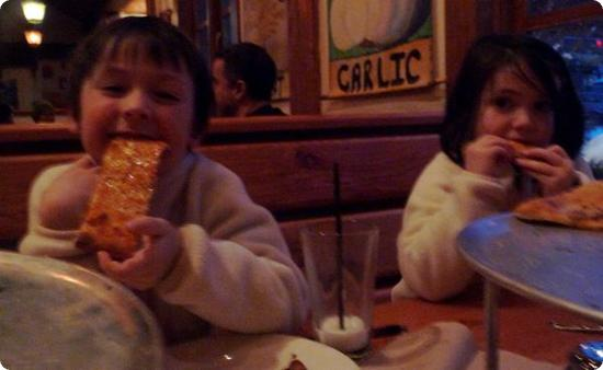 Everest and Darya feast on Creekbread's Cheese Flatbread