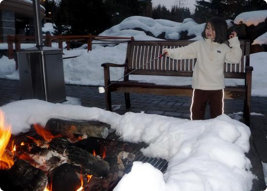 Darya bravely roasts her own marshmallow at the Four Seasons Resort Whistler fire pit