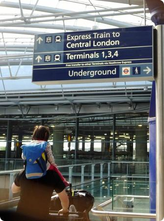 Darya gets a piggyback ride to the Heathrow Express.  Who do you think is more exhausted, her or dad?