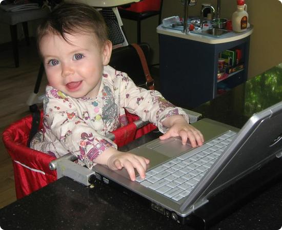 Darya (age 18 months) on the computer