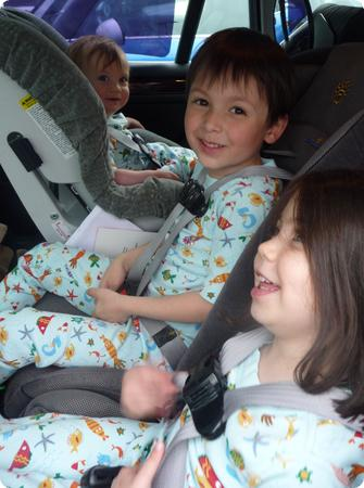 Three-across setup with all three kids in 5-point harness seats