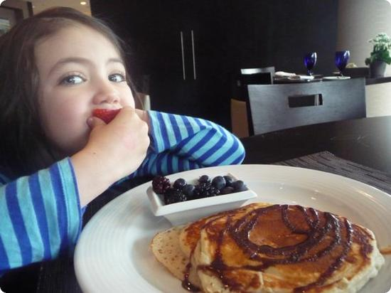Darya just loves pancakes with chocolate syrup