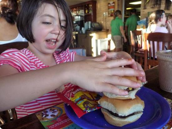 Darya digs into mini-hamburgers at the Tate Grill