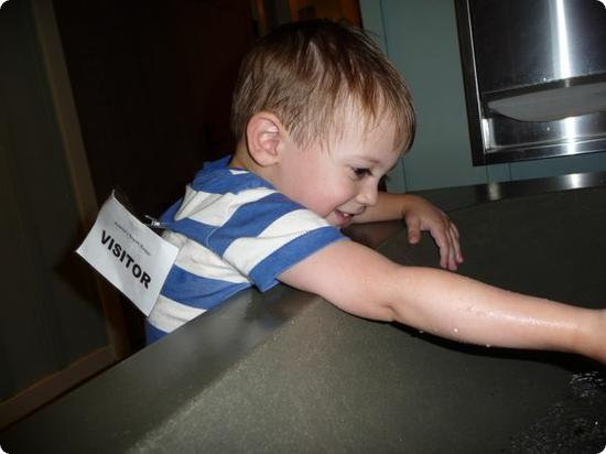 Washing hands before entering Auntie's beach house (dropoff childcare for kids 3+)