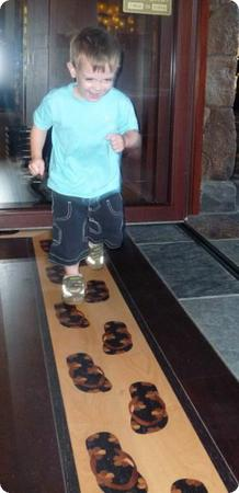 Eilan loved these little sandals, made of inlaid wood, at the entrance to Aulani's store