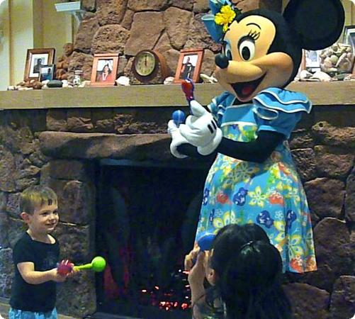 Eilan dances with Minnie Mouse during Disney Junior Aloha hour at Auntie's Beach House