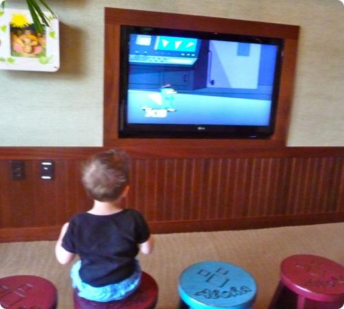 Eilan watches an early morning movie in the Aulani lobby