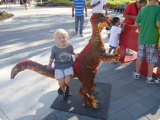 My 6 year old catches a ride on a Lego Dino at LEGOLAND FLORIDA