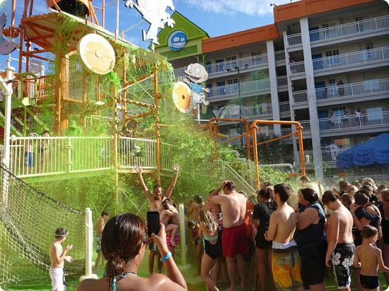 Mass sliming by the pool at Nickelodeon Suites Resort