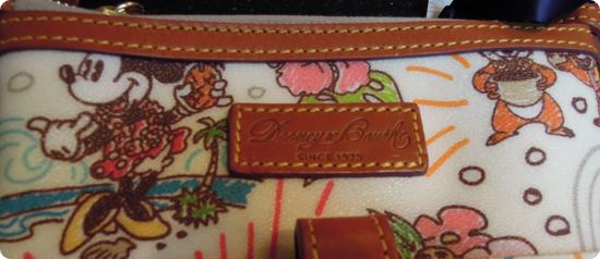 Closeup of Dooney and Bourke Logo on front of bag