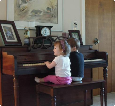 Eilan and his cousin play together on the piano that I learned music on