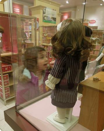 Darya admires her doll's period outfits at the American Girl Doll Store in Lynnwood, WA