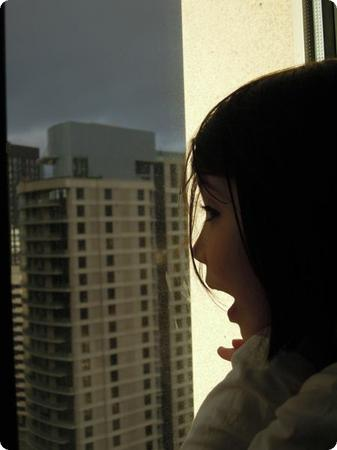 Darya admires the view at the Grand Hyatt Hotel in Seattle