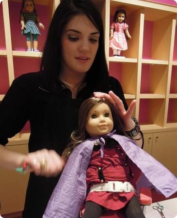 Rebecca gets her hair brushed and re-curled at the American Girl Doll store