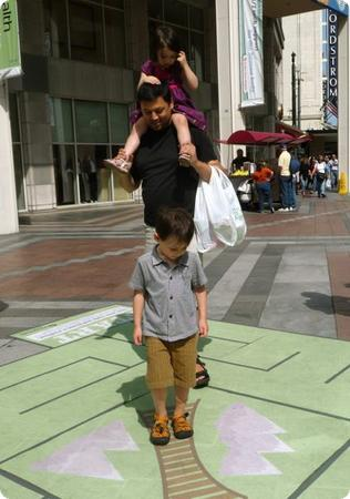 The kids enjoy a maze temporarily set up outside Westlake Center in Seattle