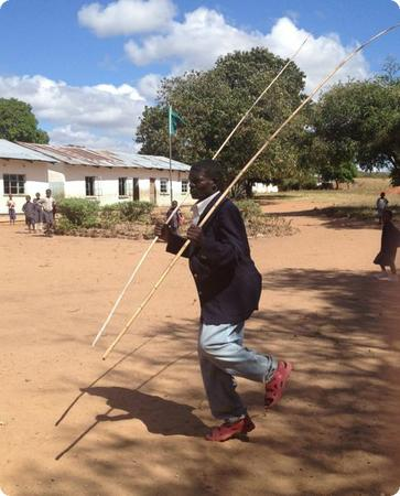 Community member dancing a Chitonga welcome dance