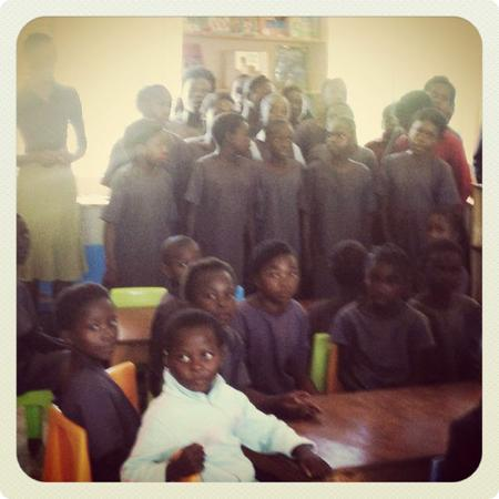 Kids at the Chilileka Basic School in Rural Zambia welcome us to their new library