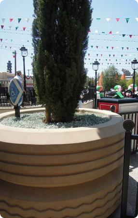 Love these details! Tire shaped planters and tire finals on the railing at Luigi's Flying Tires in Cars Land