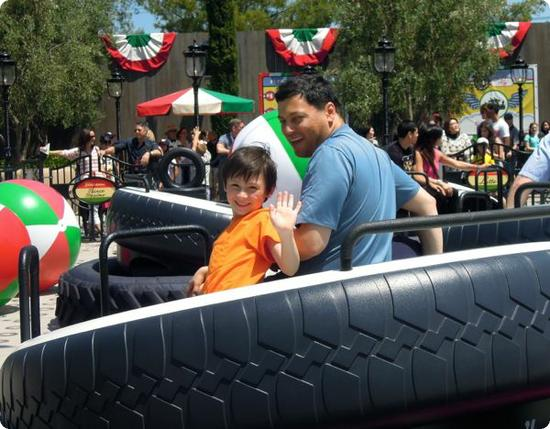 Everest and Peyman enjoying their ride at Luigi's Flying Tires