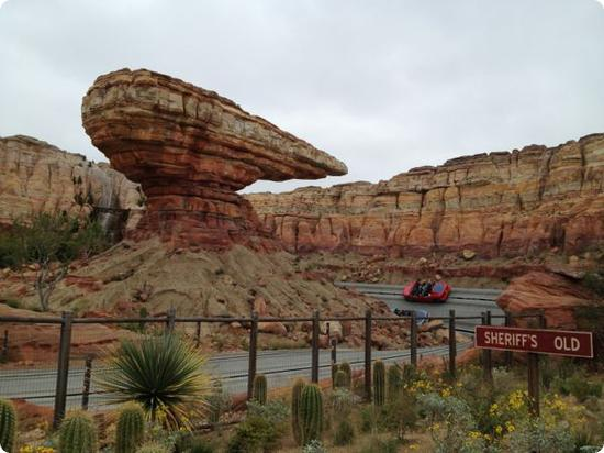 Cars race to the finish line at the Radiator Springs Racers ride in California Adventure