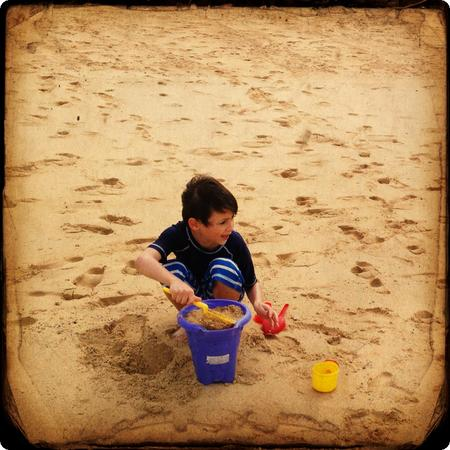He's about to start building the best sandcastle in the world.  Want to join in?