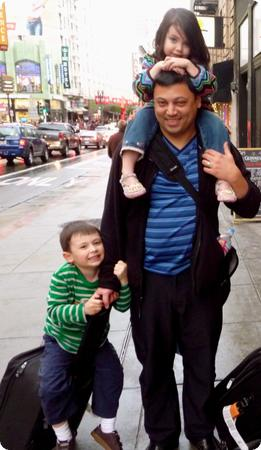 He's working up to carrying three kids and a suitcase at the same time!