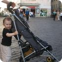 Everest pushing his stroller in the Campo De' Fiori in Rome