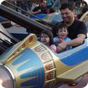 Everest and his dad ride in Disneyland's Astro Orbiter