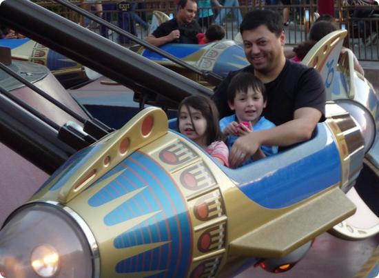 Everest and his dad ride in Disneyland's Astro Orbiter