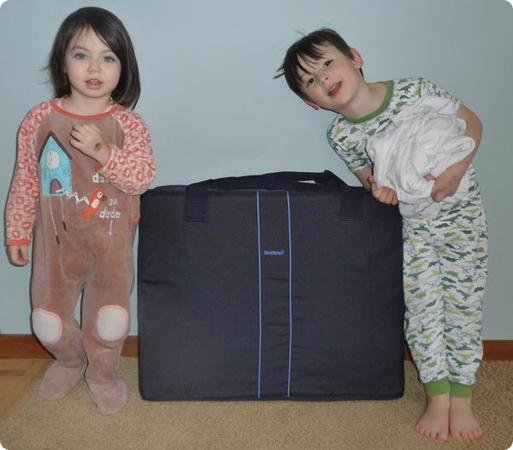 Everest and Darya help me test the Baby Bjorn Travel Cot