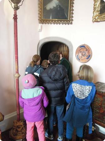 The kids cluster around our guide on a tour of Glamis Castle